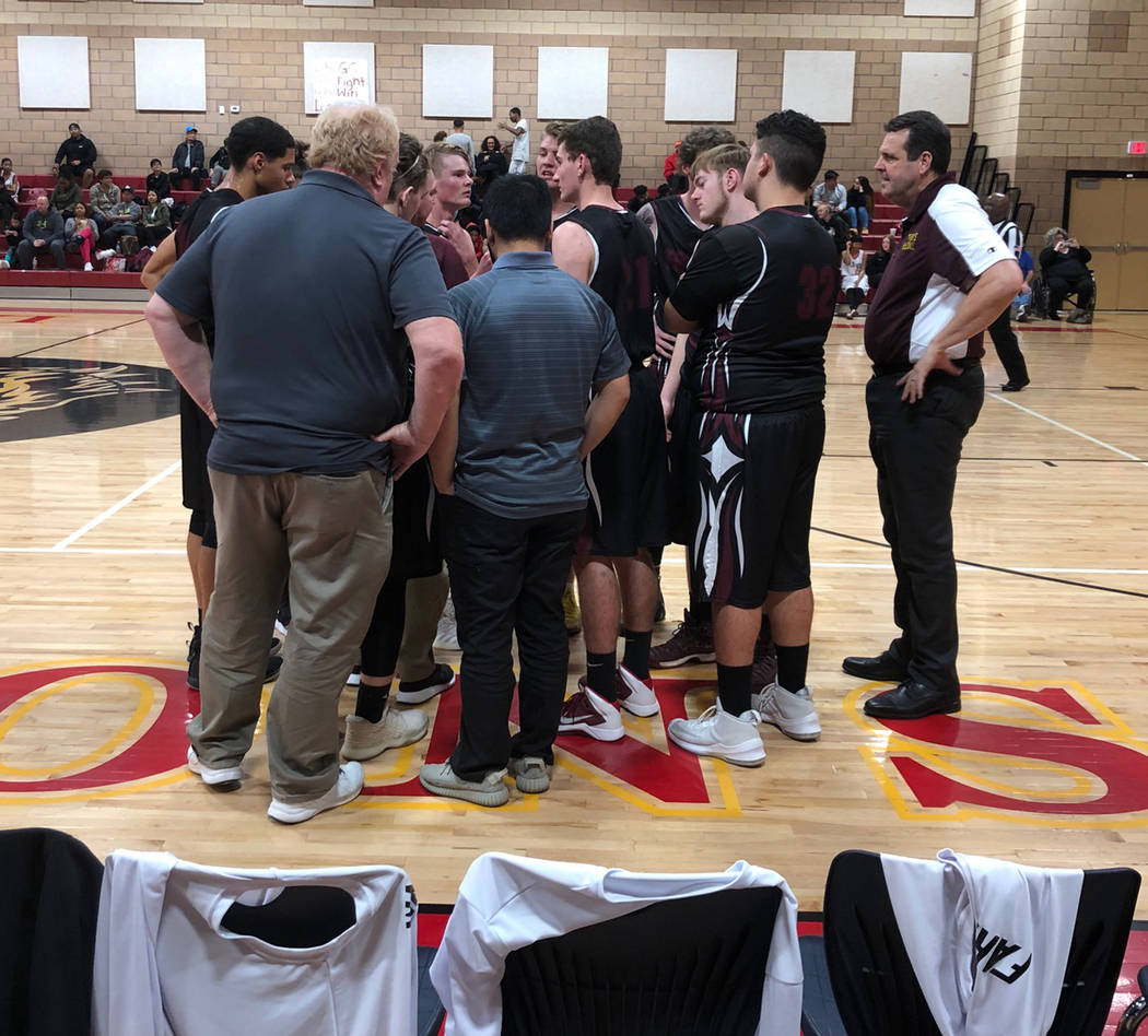 Tom Rysinski/Pahrump Valley Times The Pahrump Valley High School boys basketball team huddles up during their 61-56 loss to Somerset-Losee on Monday night in North Las Vegas.
