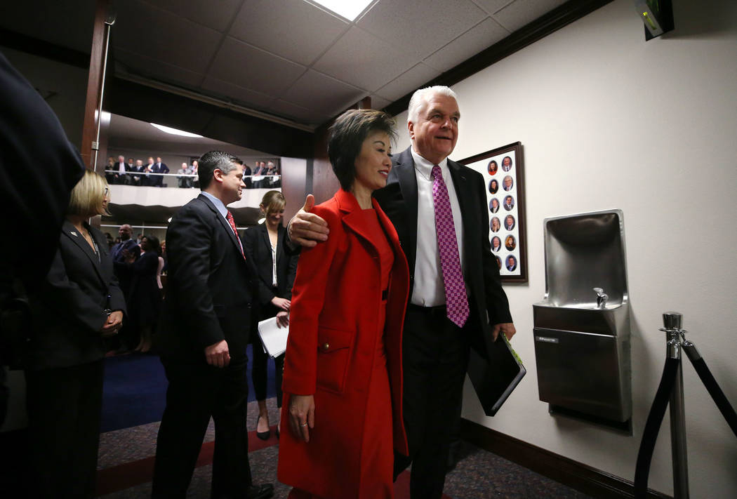 Nevada Gov. Steve Sisolak and his wife Kathy leave the Assembly chambers after delivering his State of the State address in Carson City, Nev., on Wednesday, Jan. 16, 2019. (Cathleen Allison/Las Ve ...