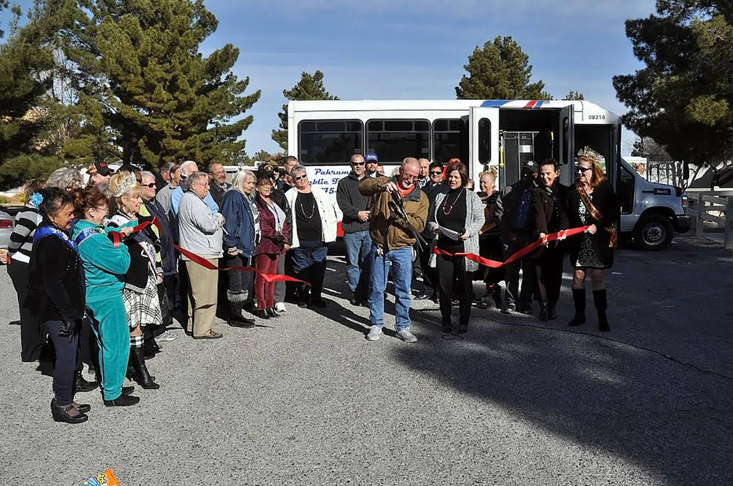 Horace Langford Jr./Pahrump Valley Times A large group of Pahrump residents gathered for the ribbon-cutting ceremony to celebrate the official hard launch of Pahrump Valley Public Transportation i ...