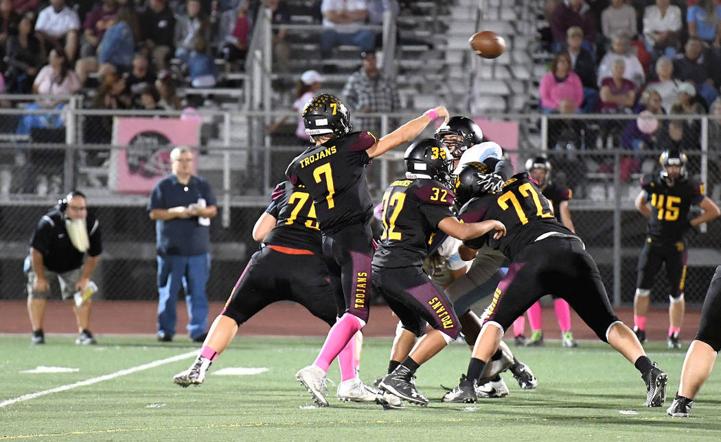 Peter Davis/Special to the Pahrump Valley Times Sports editor Tom Rysinski gets the same view as Pahrump Valley coaches as Dylan Wright unleashes a pass against Western.