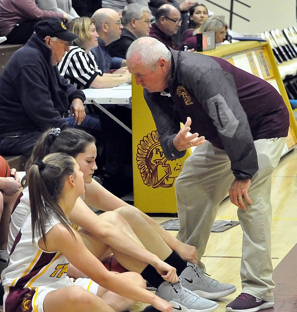 Horace Langford Jr./Pahrump Valley Times While Pahrump Valley girls basketball coach Bob Hopkins talks to his players, sports editor Tom Rysinski and everyone else at the scorer's table have their ...