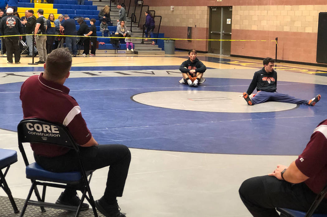 Tom Rysinski/Pahrump Valley Times Pahrump Valley wrestling coach Craig Rieger, left, will bring six wrestlers to the Class 3A state championships this weekend in Winnemucca, including region champ ...