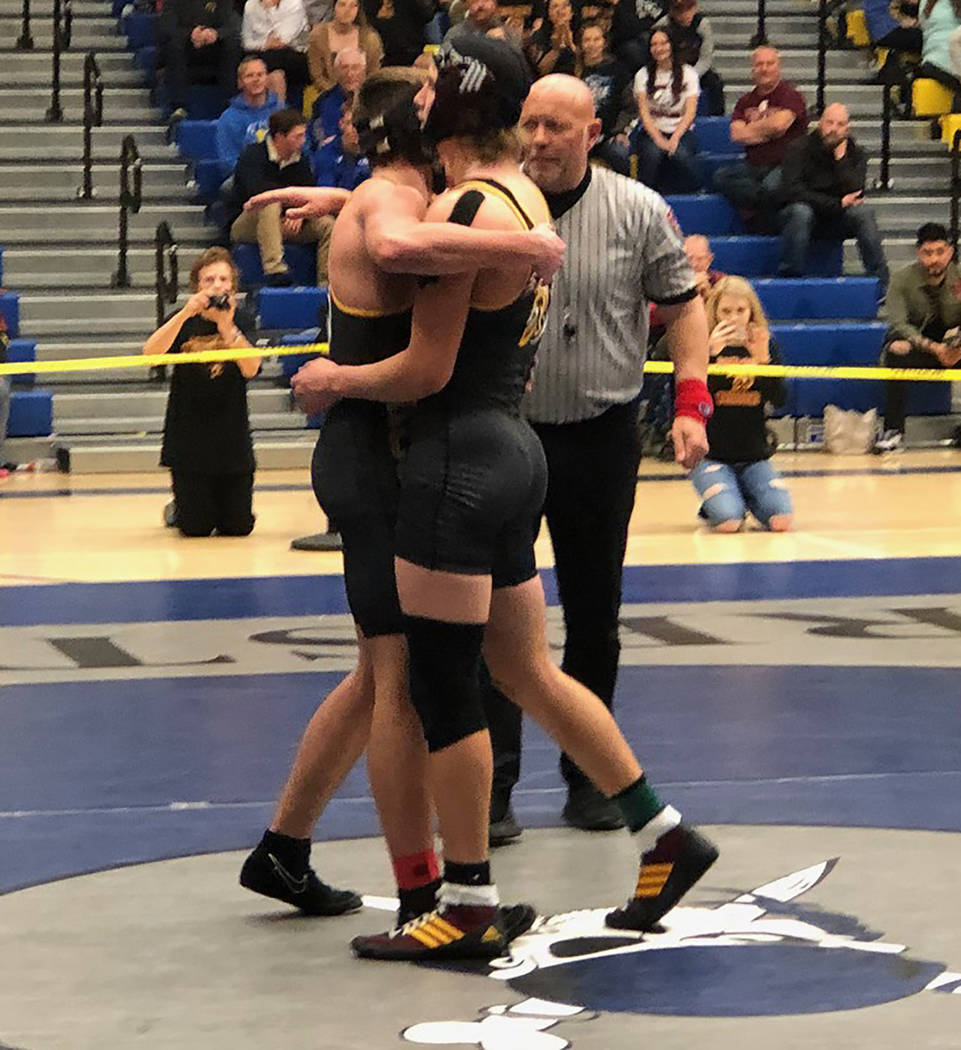 Tom Rysinski/Pahrump Valley Times Senior Tristan Maughan, left, and sophomore Dylan Wright embrace after Wright's 15-8 decision over Maughan in the Class 3A Southern Region 160-pound final Saturda ...