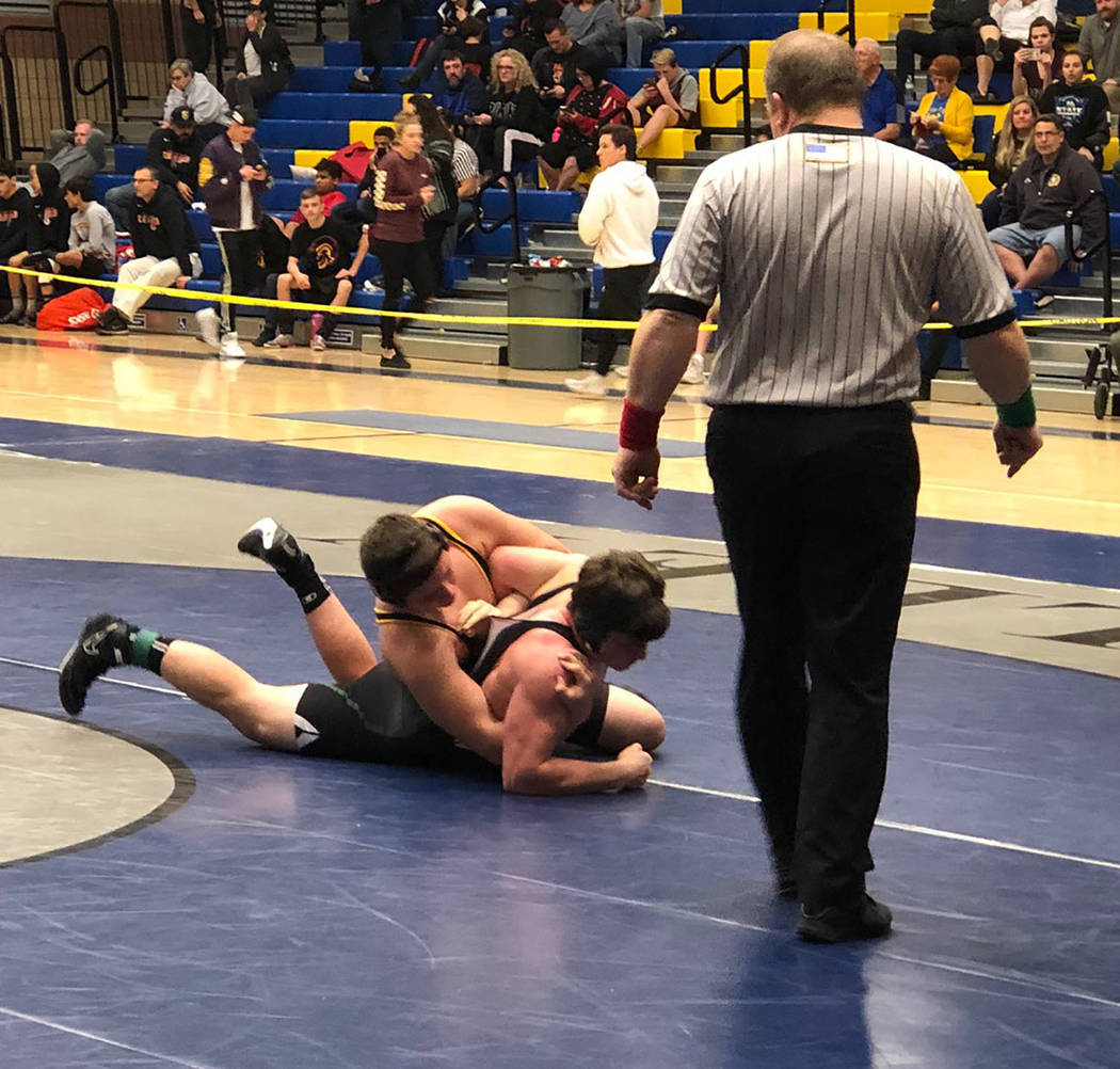 Tom Rysinski/Pahrump Valley Times Sophomore Anthony Pearson of Pahrump Valley has Virgin Valley sophomore Shane Zarate in his grasp during the Class 3A Southern Region consolation semifinals at 19 ...