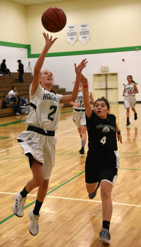 Richard Stephens/Special to the Pahrump Valley Times Beatty senior Andrea Leon goes up for 2 of her 8 points during the Hornets' loss to Word of Life on Jan. 29 in Beatty.