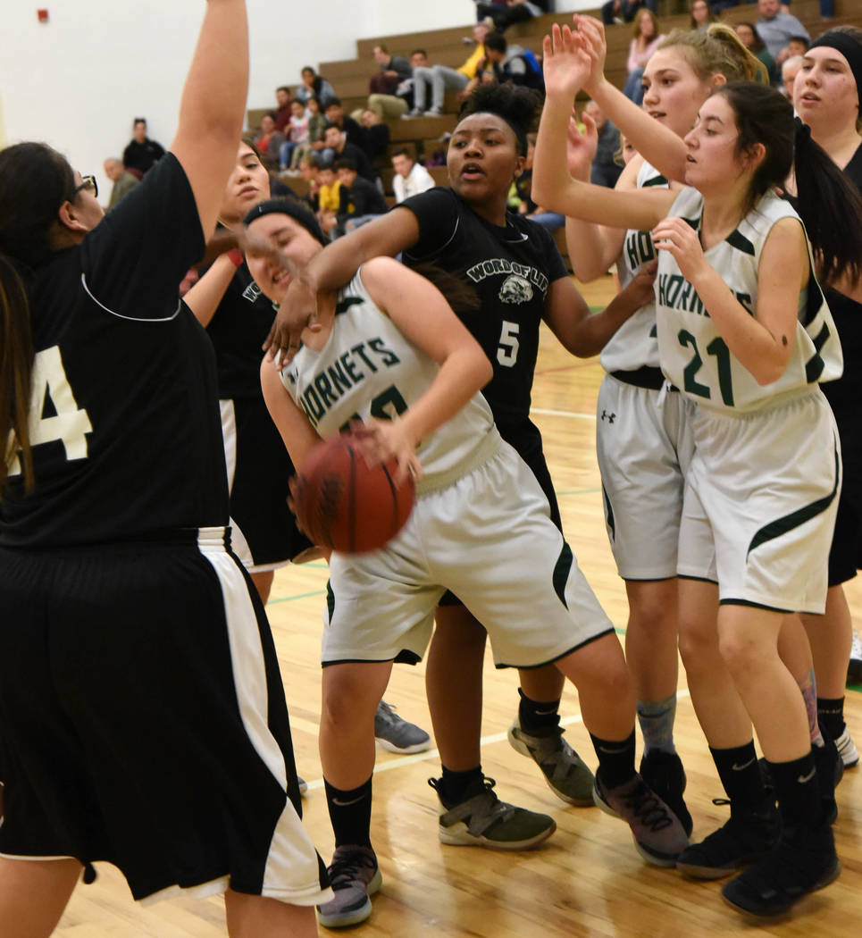 Richard Stephens/Special to the Pahrump Valley Times Beatty sophomore Marlene Damian wins a battle for possession during the Hornets' game against Word of Life on Jan. 29 in Beatty.