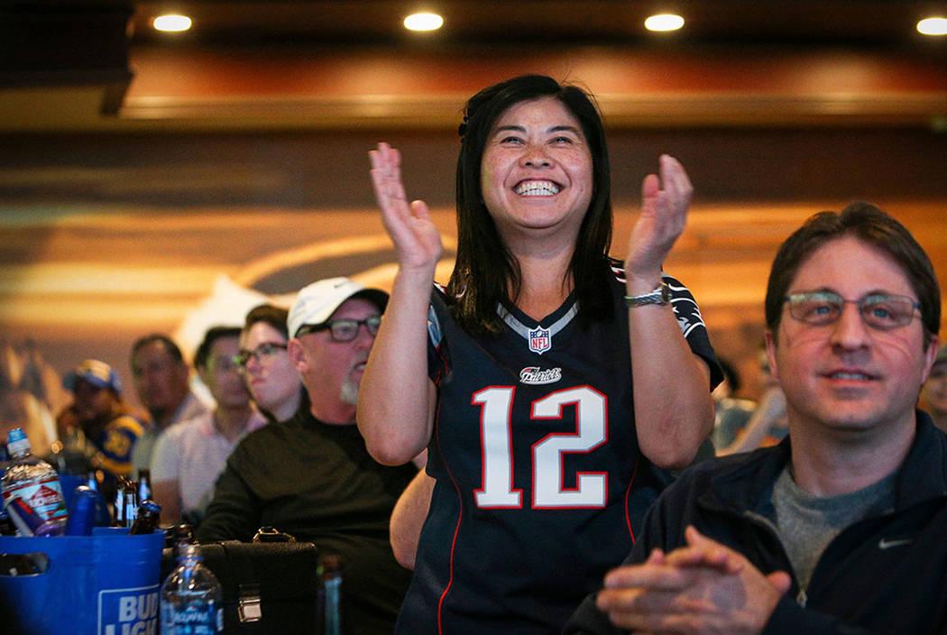 People react as they watch Super Bowl LIII at the Westgate Superbook in Las Vegas in Las Vegas, Sunday, Feb. 3, 2019. (Caroline Brehman/Las Vegas Review-Journal)