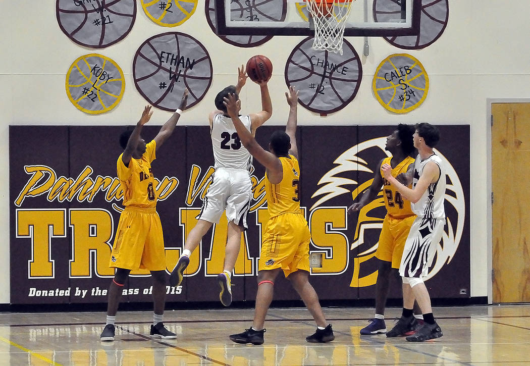 Horace Langford Jr./Pahrump Valley Times Pahrump Valley senior Brayden Severt goes up for 2 of his team-high 24 points Tuesday night against Del Sol in Pahrump.