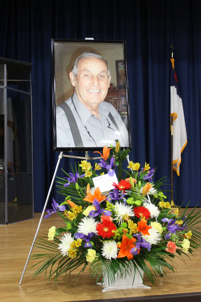 Robin Hebrock/Pahrump Valley Times Photos of Hollis Harris and bouquets of flowers lined the stage at the Celebration of Life hosted Saturday, Feb. 2 at the Pahrump Community Church.
