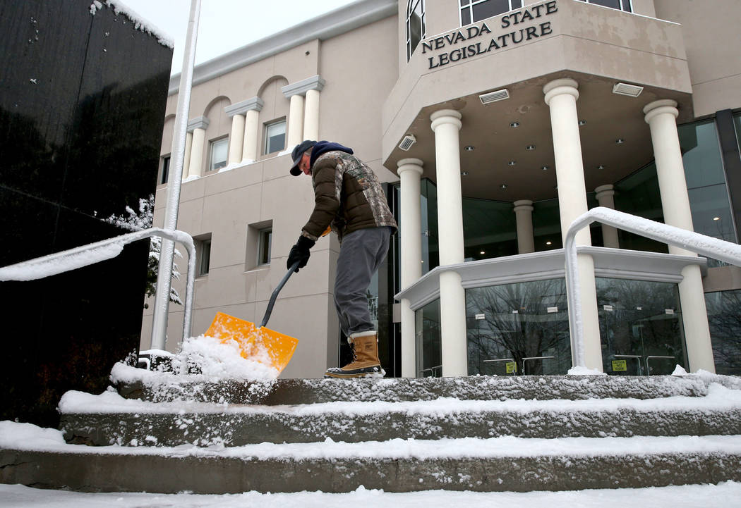 K.M. Cannon/Las Vegas Review-Journal Randy Bird shovels snow in front of the Legislative Building in Carson City on the first day of the 80th session of the Nevada Legislature Monday, Feb. 4, 2019.