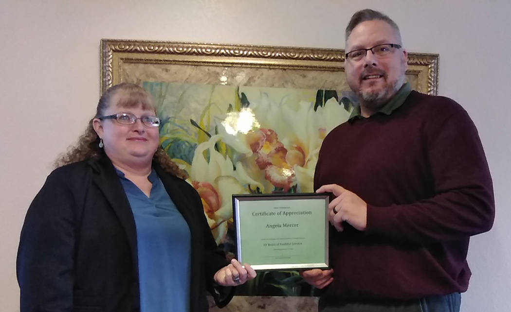 Selwyn Harris/Pahrump Valley Times Lee Funeral Home Licensed Funeral Director and General Manager Angela Mercer receives the Valued Employee Award for her 10 years of service within the community. ...