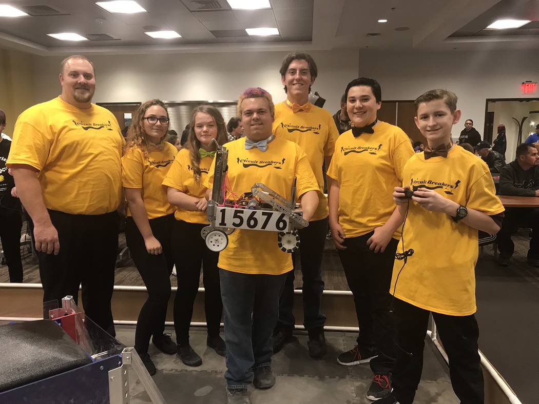 Jeffrey Meehan/Pahrump Valley Times A FIRST (For Inspiration and Recognition of Science and Technology) Tech Challenge (FTC) known as the Circuit Breakers stands at a fundraising event at the Vall ...