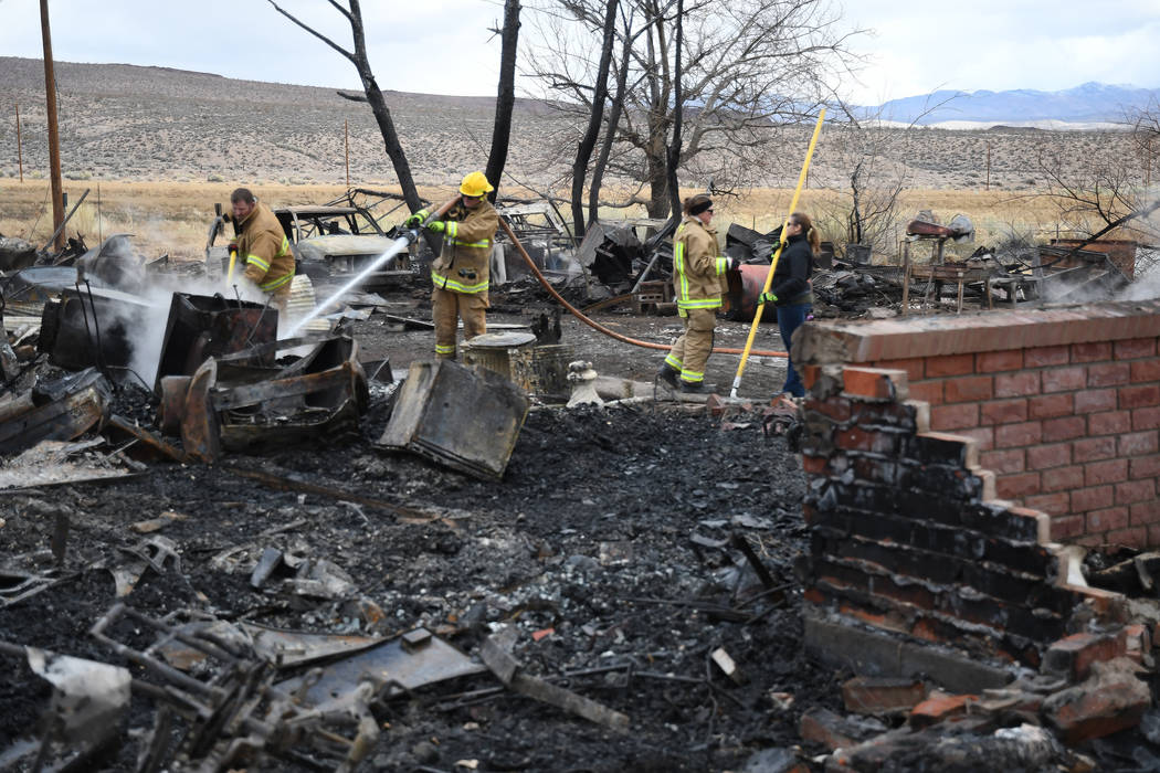 Richard Stephens/Special to the Pahrump Valley Times Beatty firefighters were called to the scene again the next morning by State Fire Marshal Investigator Michael Kolpak, who discovered some flar ...