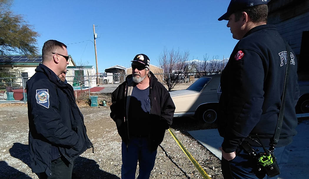 Selwyn Harris/Pahrump Valley Times John Benedict, center, owner of Pahrump's JonAire Heating, Cooling and Refrigeration, speaks to Michael Kolpak, investigator with the Nevada State Fire Marshal D ...