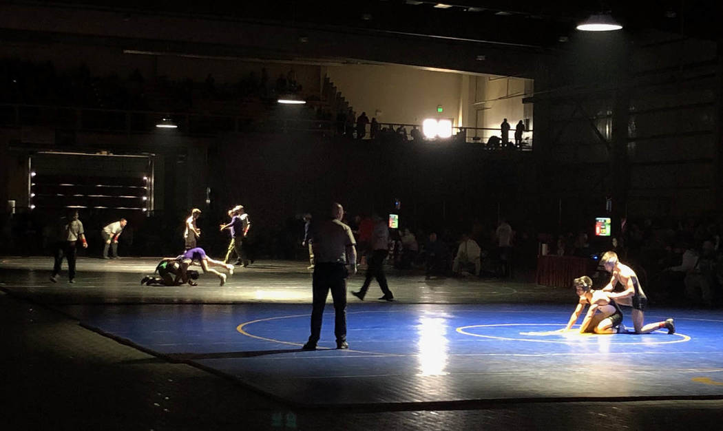 Tom Rysinski/Pahrump Valley Times Championship-round bouts at the NIAA State Wrestling Championships were held under the spotlights Saturday at the Winnemucca Events Center. At left is the Class 2 ...