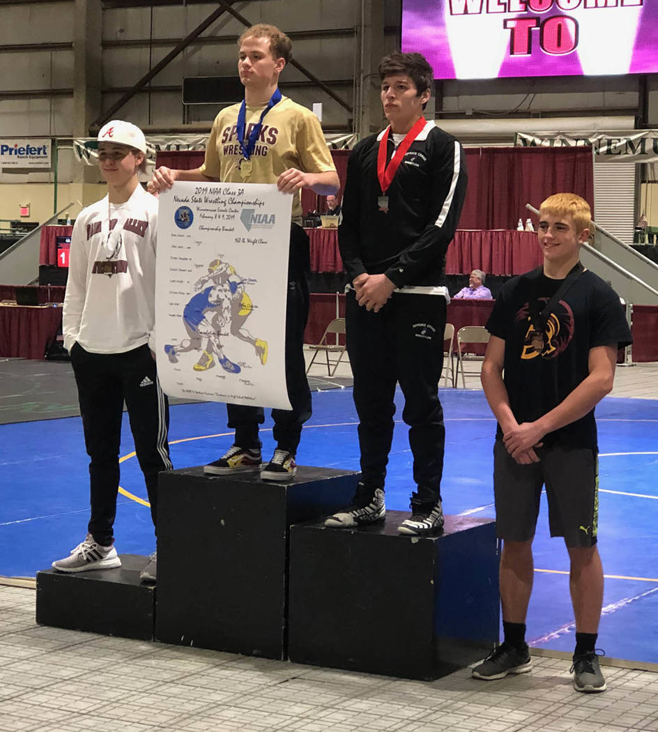 Tom Rysinski/Pahrump Valley Times The 160-pound medal stand at the Class 3A Wrestling Championships on Saturday in Winnemucca. From left, third-place Dylan Wright of Pahrump Valley, first-place Ty ...