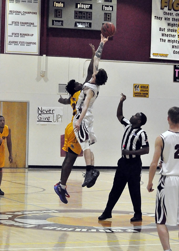 Horace Langford Jr./Pahrump Valley Times Senior forward Chance Farnsworth, here at the opening tip against Del Sol, scored 27 points in two games for Pahrump Valley in the past week.