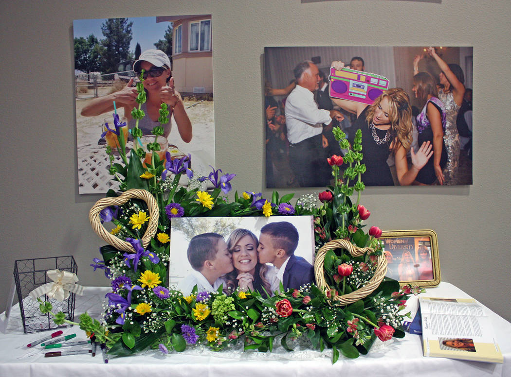 Robin Hebrock/Pahrump Valley Times Displays of flowers and pictures filled the venue of the memorial for Pahrump community leader Cassandra Selbach, who passed away in January.