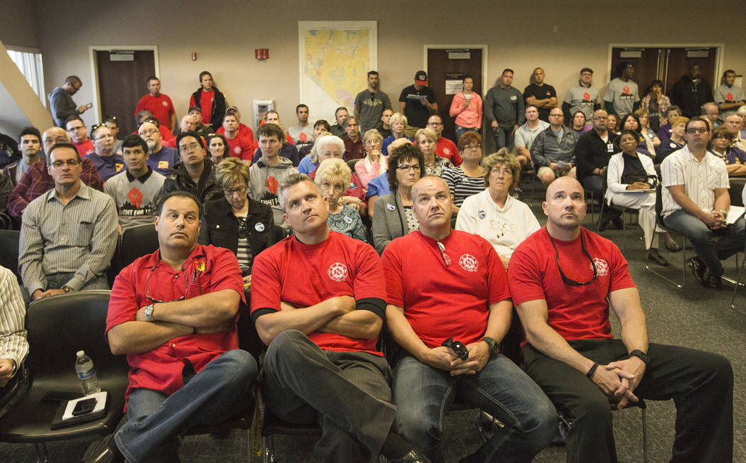 Members of the Professional Firefights of Nevada union listen during the Assembly Ways and Means Committee telecast hearing on AB190 hearing Wednesday, April 15, 2015, at the Sawyer Building, 555 ...