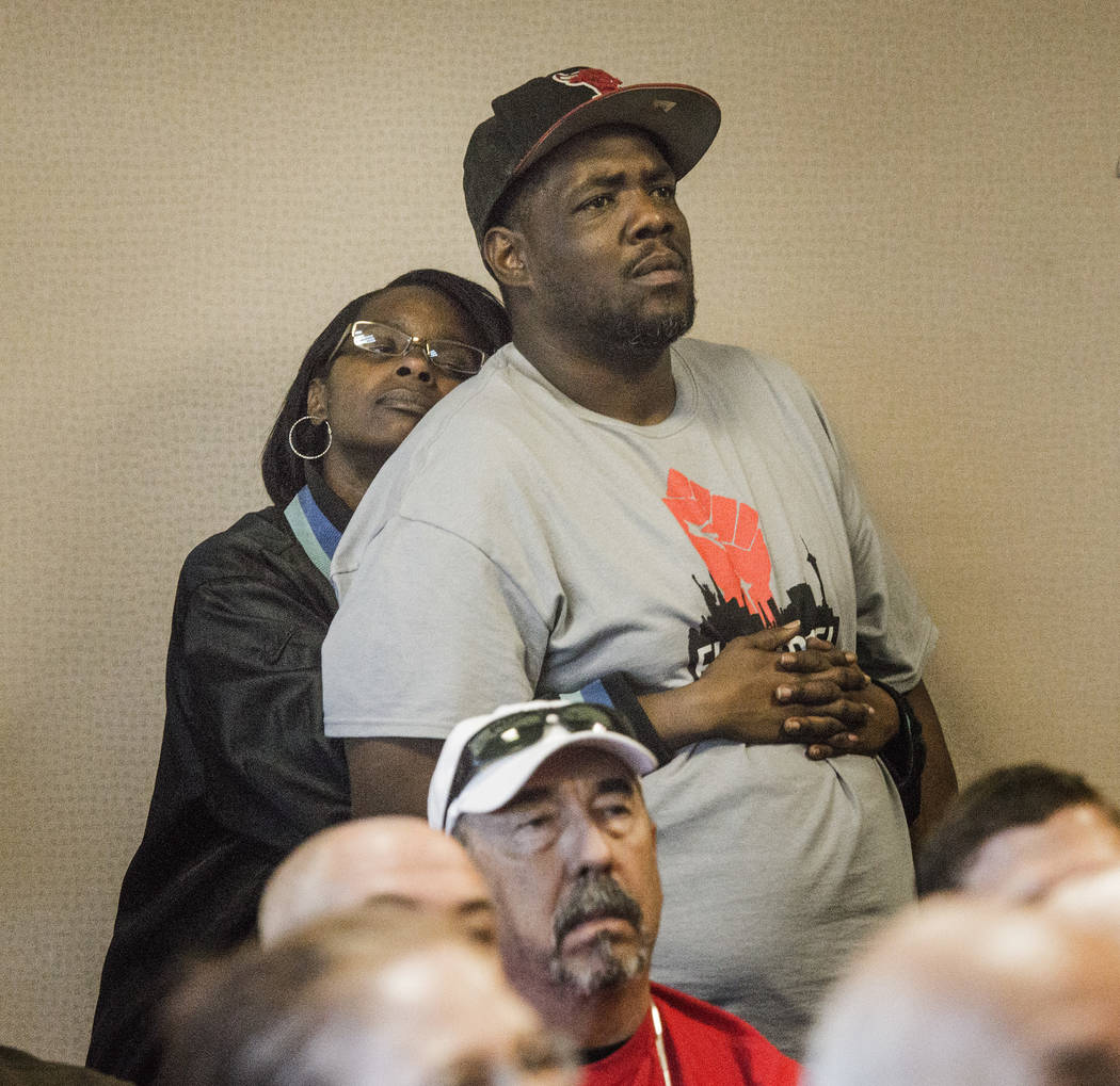 Fast food workers Tim Howard, right, and his wife Anatasia listen during the Assembly Ways and Means Committee telecast hearing on AB190 hearing Wednesday, April 15, 2015, at the Sawyer Building ...