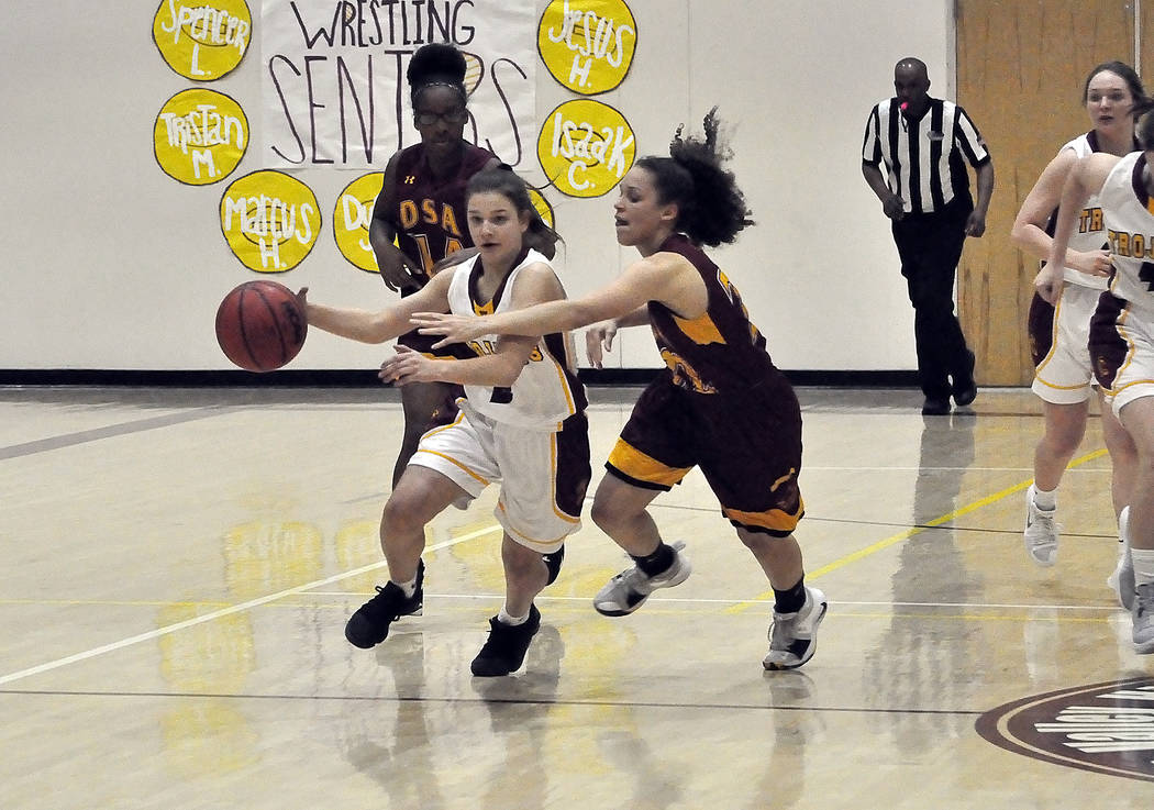 Horace Langford Jr./Pahrump Valley Times Pahrump Valley freshman Tayla Wombaker, shown bringing the ball up the floor against Del Sol, scored 22 points Wednesday night as the Trojans defeated Moja ...