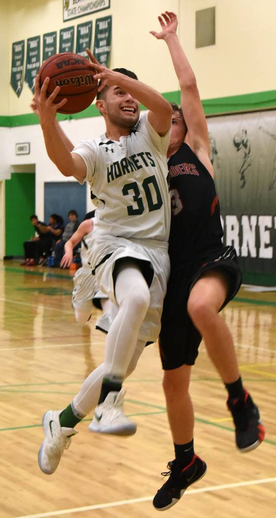 Richard Stephens/Special to the Pahrump Valley Times Beatty senior Geo Maldonado drives to the basket against Sandy Valley on Friday night during the Hornets' 65-55 victory over the Sidewinders.