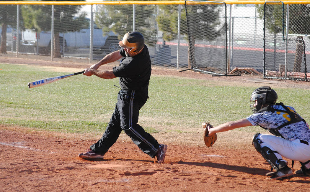 Charlotte Uyeno/Pahrump Valley Times Rich Lauver connects with a double to start a rally during the eighth inning that carried the Pahrump Valley alumni to an 11-3 win over current players in the ...