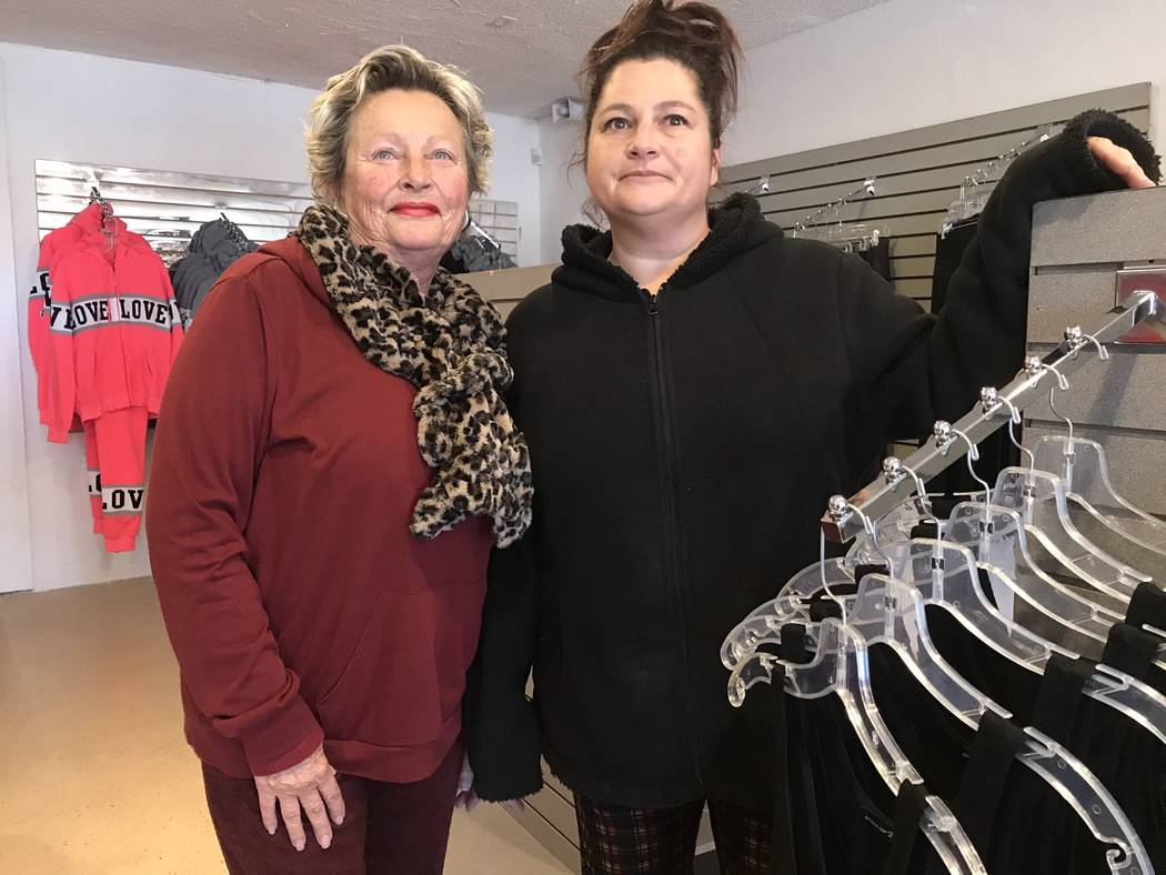 Jeffrey Meehan/Pahrump Valley Times Nicole McLaughlin (right) stands with her mother, Suzanne Robbins (left) at her newly opened clothing store Off the Street in Pahrump. McLaughlin opened the new ...