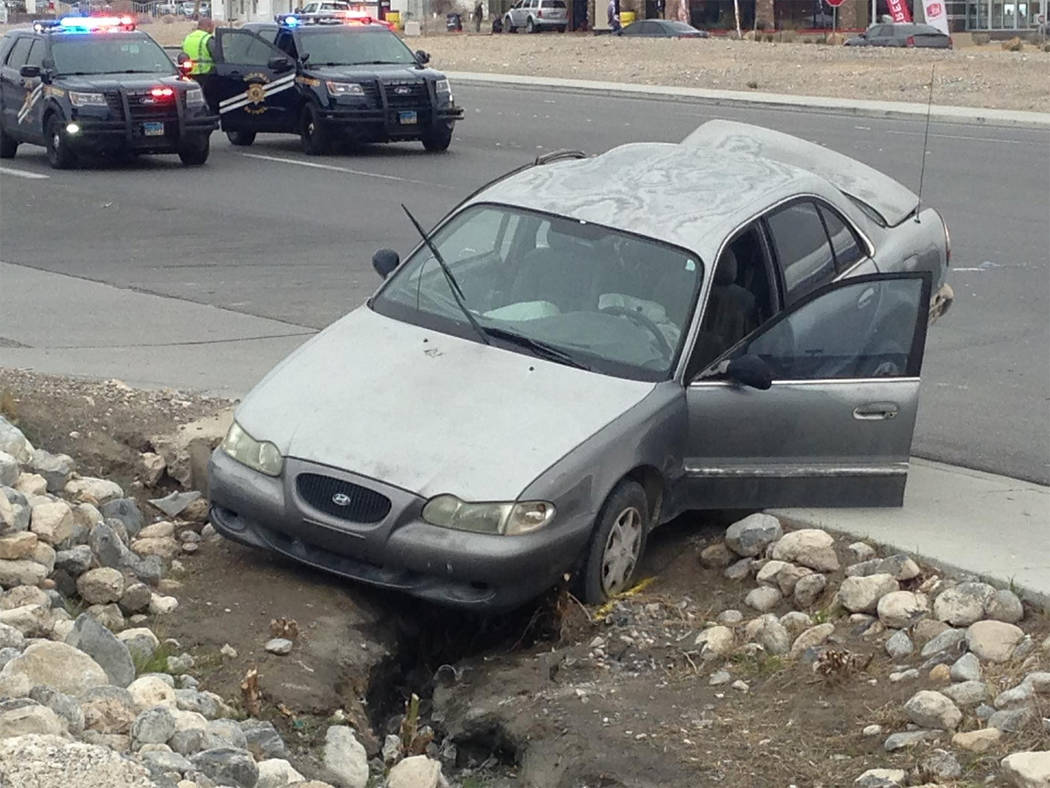 Special to the Pahrump Valley Times An early model grey Hyundai sedan, with airbags deployed, sustained major damage in the aftermath of the Sunday afternoon crash. The sheriff's office has yet to ...