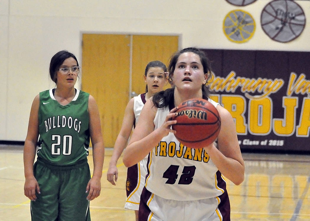 Horace Langford Jr./Pahrump Valley Times Pahrump Valley sophomore forward Kate Daffer lines up a free throw Tuesday night against Virgin Valley. Daffer led the Trojans with 12 points in their 47-2 ...