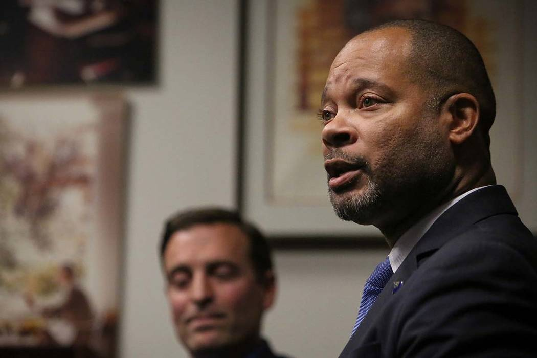Nevada's incoming Democratic Attorney General Aaron Ford speaks as outgoing Republican Attorney General Adam Laxalt listens during a press briefing in Las Vegas, Dec. 17, 2018. (Caroline Brehman/L ...