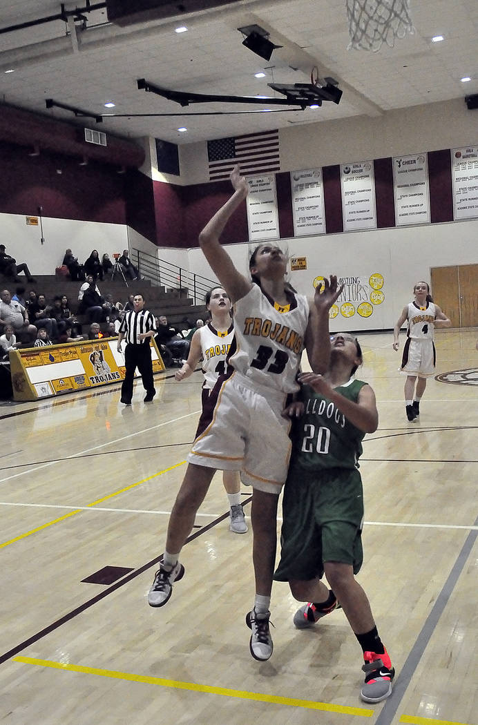 Horace Langford Jr./Pahrump Valley Times Sophomore forward Nicky Velazquez goes up for a layup during a Feb. 17 tournament game against Virgin Valley in Pahrump. The Trojans won 47-26.