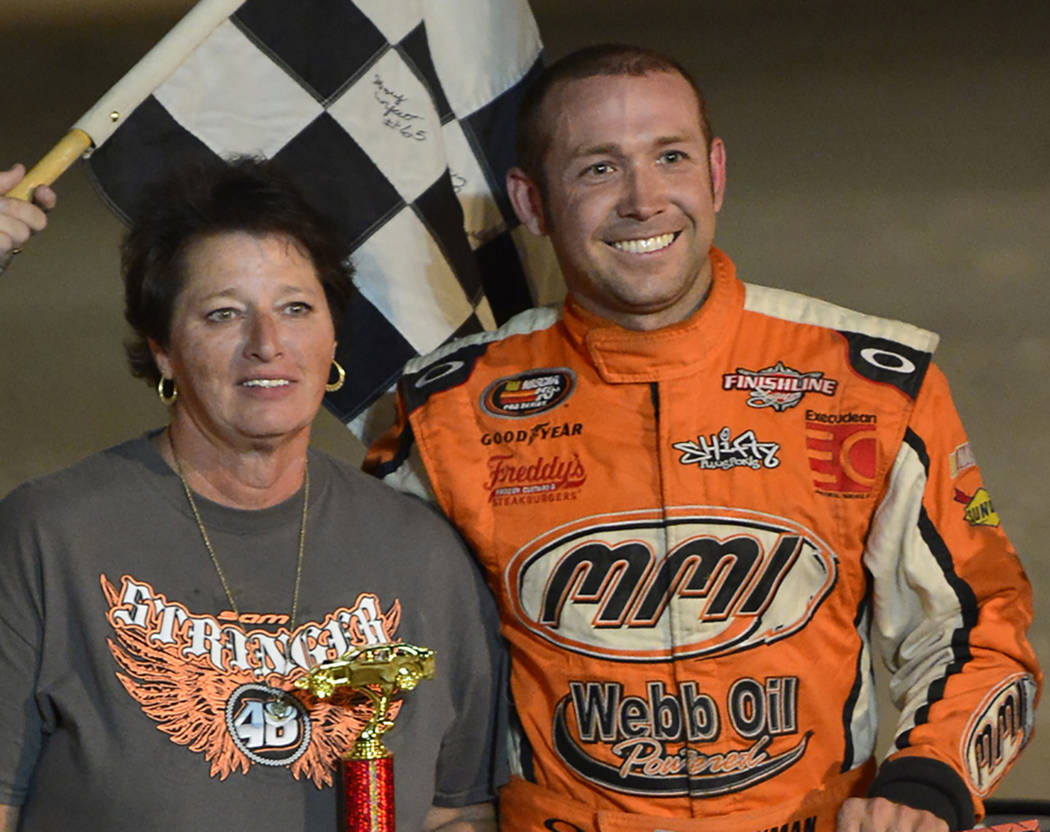 Instant Images/Special to the Pahrump Valley Times Kyle Heckman, winner of the 2014 Sam Stringer Memorial race, poses with Sheree Stringer, the organizer of the race at Pahrump Valley Speedway.