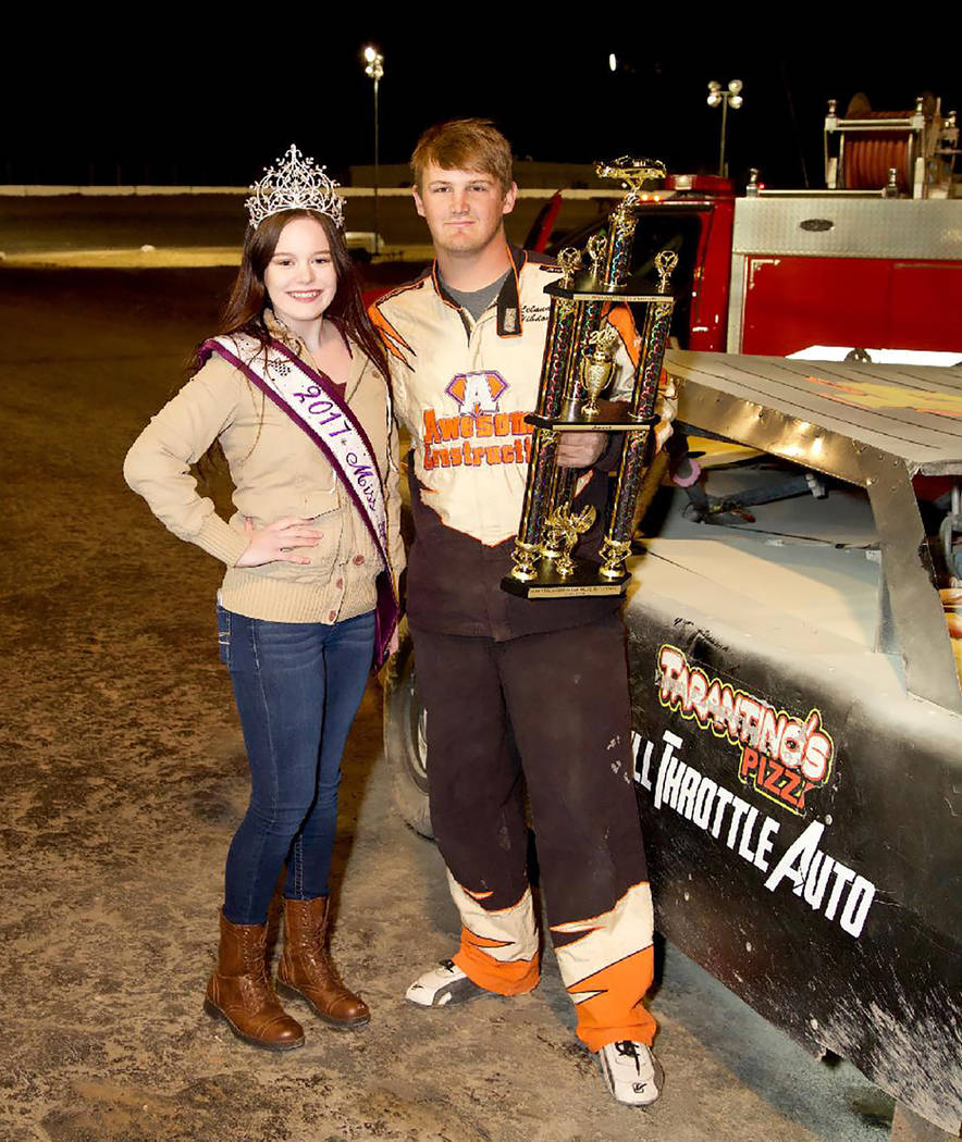 Judy Maughan/Special to the Pahrump Valley Times Shelby Ledford presents the trophy to Austin Kiefer after his victory in the Sam Stringer Memorial Race on March 3, 2018, at Pahrump Valley Speedway.