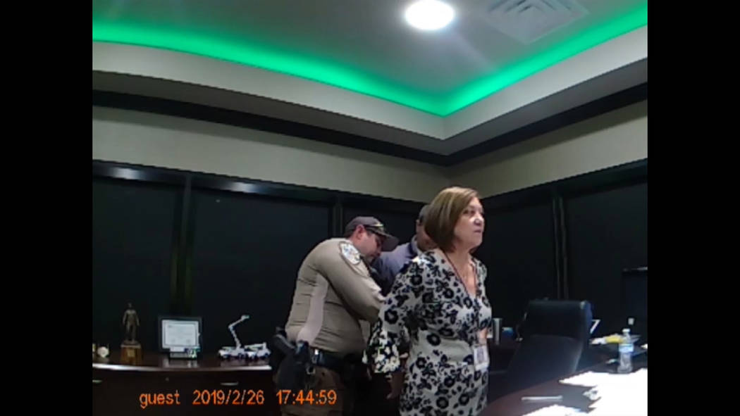 Nye County Sheriff's Office video screenshot Nye County Sheriff's Office body-cam footage show Valley Electric Association CEO Angela Evans being arrested at the co-op's administrative offices at ...