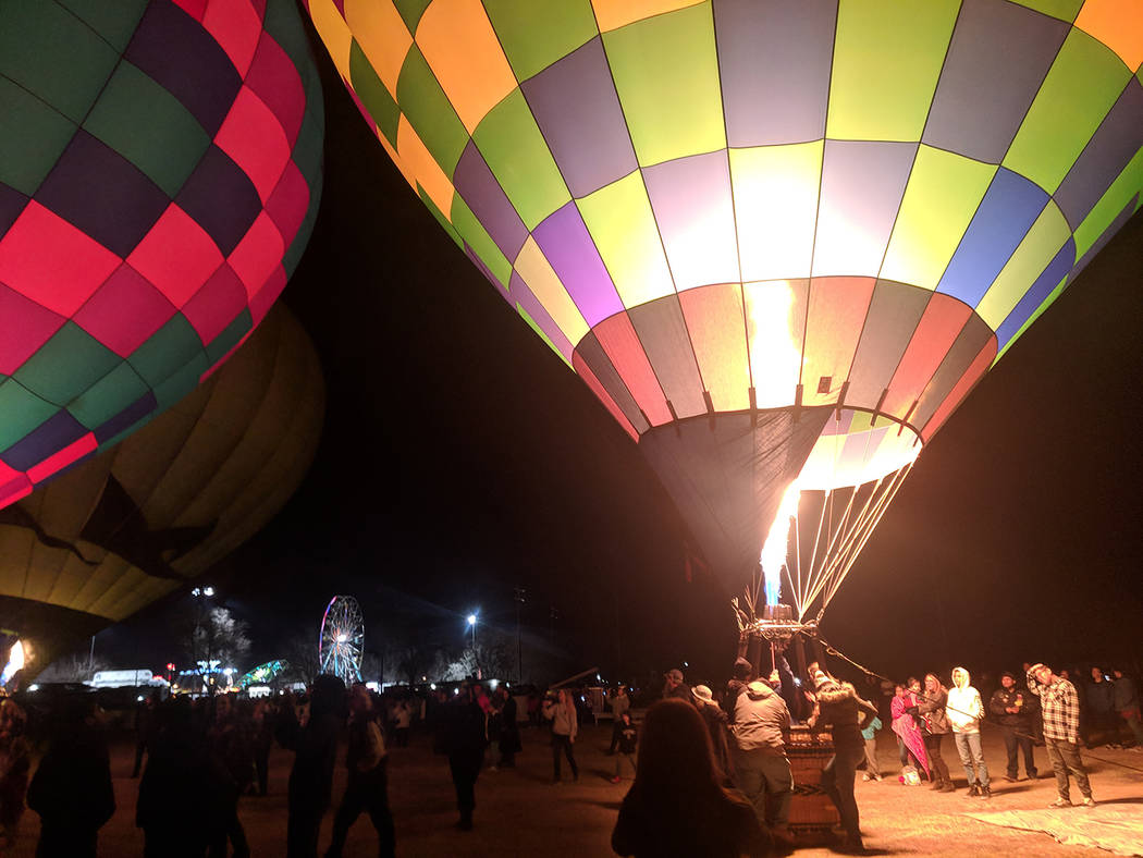 Jolina Mackool/Special to the Pahrump Valley Times Jets of flame lit up the dark night at the Balloon Glow, where several hot air balloons were set up for an amazing light show. Huge crowds gather ...