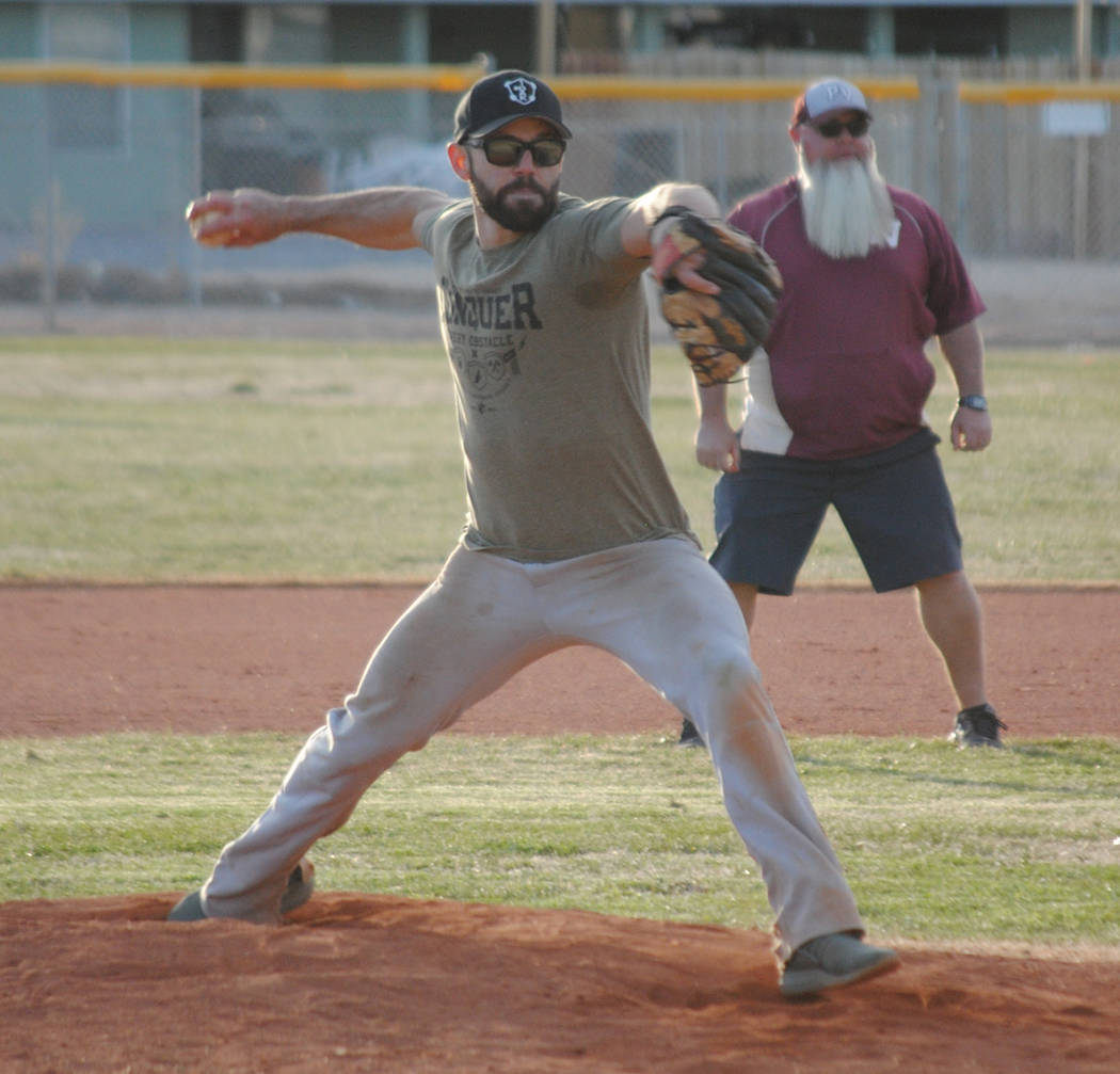 Charlotte Uyeno/Pahrump Valley Times Cody Nielsen, Class of 2008, delivers a pitch Saturday during the Maroon and Gold alumni exhibition game at Pahrump Valley High School.