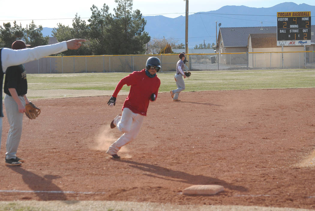 Charlotte Uyeno/Pahrump Valley Times Rounding third and heading for home, Nick Wagner, Pahrump Valley Class of 2002, returned to Pahrump from Florida and drove in two runs for the alumni team duri ...