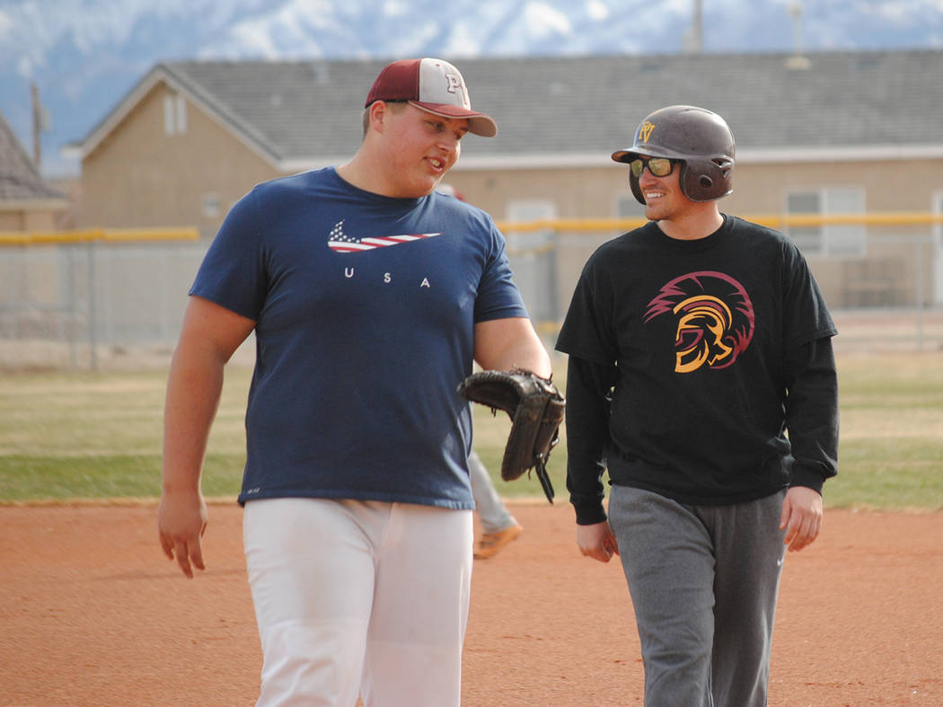 Charlotte Uyeno/Pahrump Valley Times Pahrump Valley senior Zach Trieb, left, talks with Aaron Pike, Class of 2012, during the school's Maroon and Gold Alumni Day on Saturday.