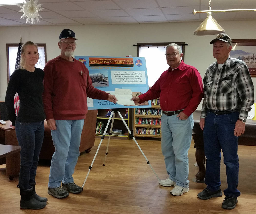 Special to the Pahrump Valley Times Acres Cannabis representatives Melanie Morales, and Mike Cottingim, left stands aside Curt Stengel, and Jim Rook from Amargosa Seniors Inc., for a special $5,00 ...