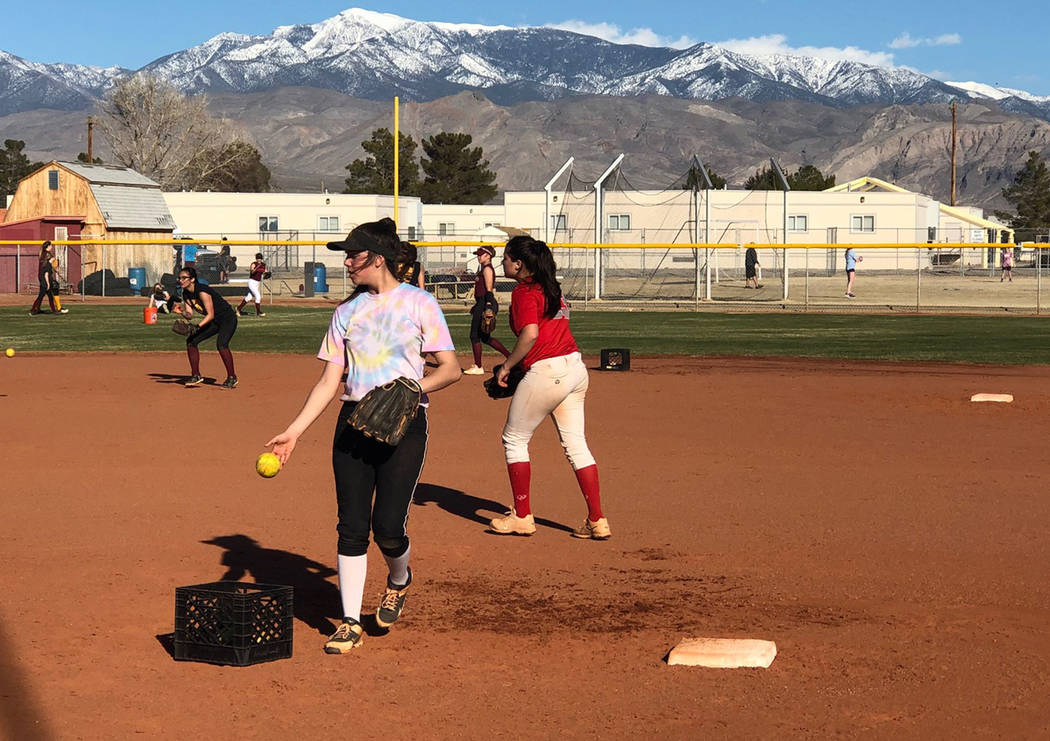 Tom Rysinski/Pahrump Valley Times Pahrump Valley High School softball players take infield practice during a Feb. 28 preseason practice at the school.