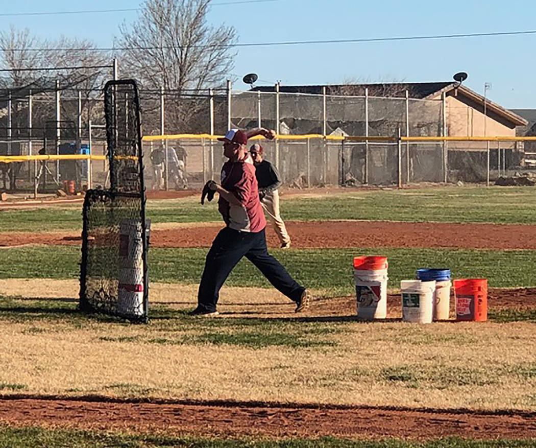 Tom Rysinski/Pahrump Valley Times Pahrump Valley High School baseball coach Brian Hayes delivers a pitch during a drill at practice Feb. 28 at the high school. Hayes is entering his seventh season ...