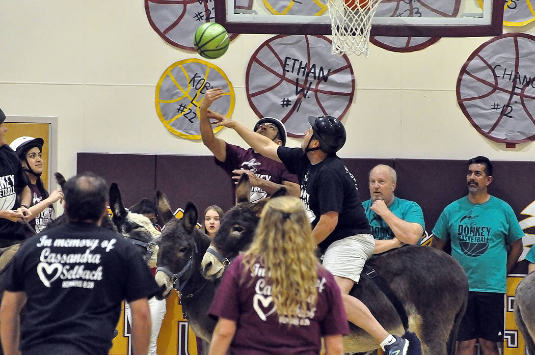 Horace Langford Jr./Pahrump Valley Times It's On Like Donkey Kong, in black, a team representing the Pahrump Chamber of Commerce, competes against a team made up of Pahrump Valley High School facu ...