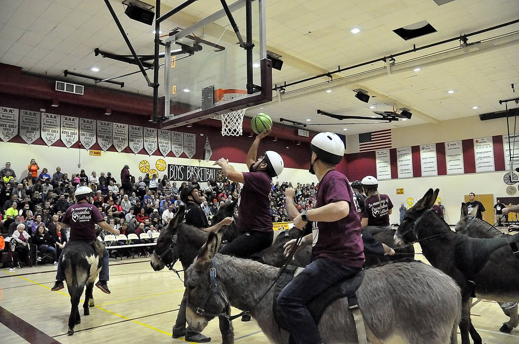 Horace Langford Jr./Pahrump Valley Times A packed house watches as the Pahrump Valley High School faculty/staff team goes in for a score during Friday night's Donkey Basketball game at the high sc ...