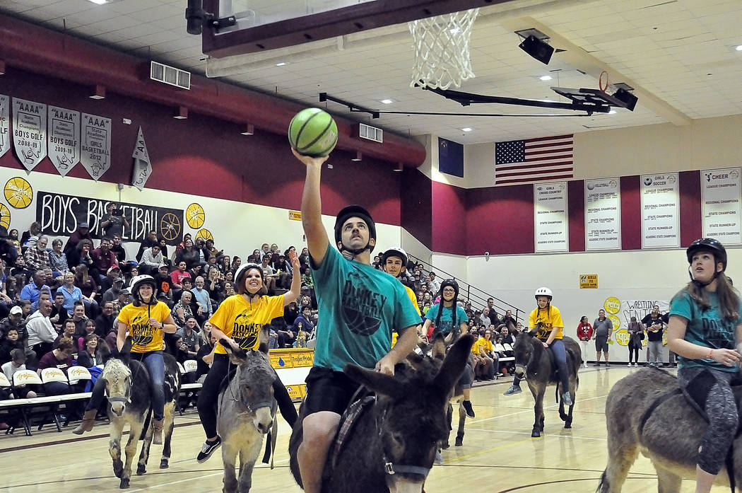 Horace Langford Jr./Pahrump Valley Times A fast break is never a guarantee of a basket in Donkey Basketball, an annual fundraising game sponsored by the faculty and staff at Pahrump Valley High Sc ...
