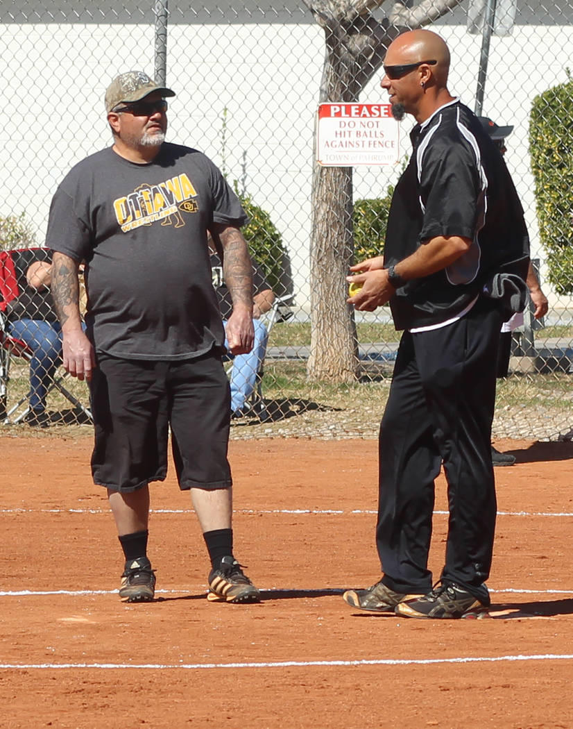 Tom Rysinski/Pahrump Valley Times Umpires Dom Sandoval and Shawn Mendoza plot how to maintain order between innings of the Batting 1.000 Challenge on Sunday at Petrack Park.