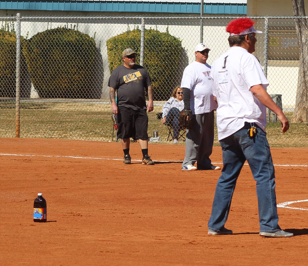 Tom Rysinski/Pahrump Valley Times Pahrump Youth Softball Association players graciously provided VFW/VFW Auxiliary shortstop K.C. Connell with a bottle of prune juice to help him keep his, um, adr ...