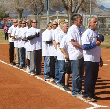 Tom Rysinski/Pahrump Valley Times Players from the VFW/VFW Auxiliary team line up along the first base line for the Pledge of Allegiance before the Batting 1.000 Challenge against the Pahrump Yout ...