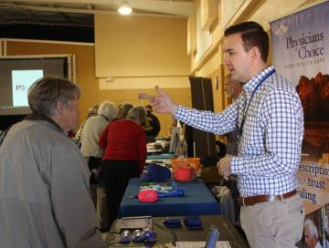 Robin Hebrock/Pahrump Valley Times A representative with Physicians Choice Home Health Care speaks with an attendee at the P3 Medical Group Health Information Fair, hosted in February.