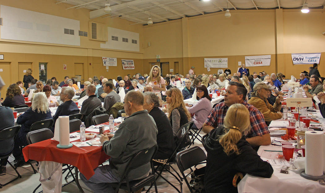 Robin Hebrock/Pahrump Valley Times The NyE Communities Coalition Activities Center was filled with patrons of this year's CASA Crab Fest.
